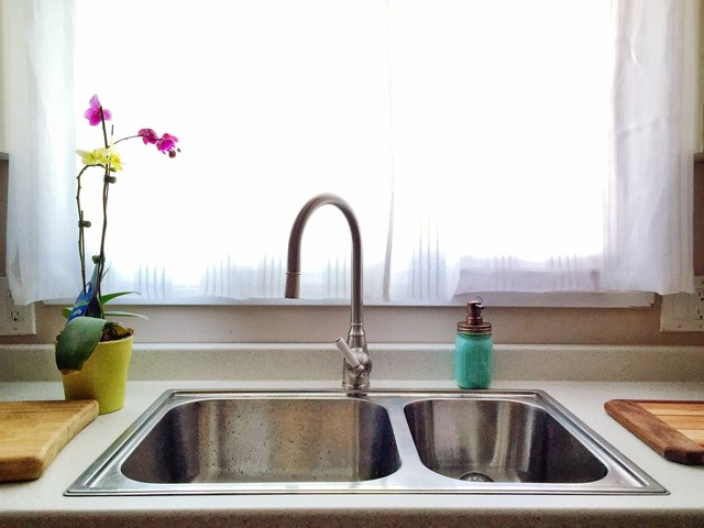 Faucet And Sink Against Window At Home