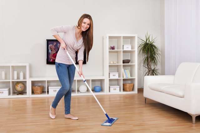 Young Woman Cleaning Floor