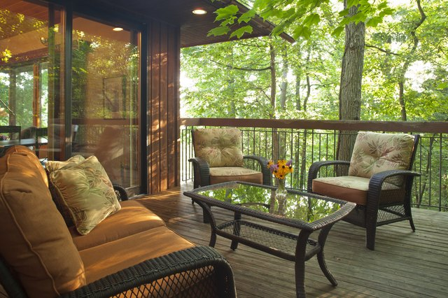 Deck with outdoor furniture in wooded setting