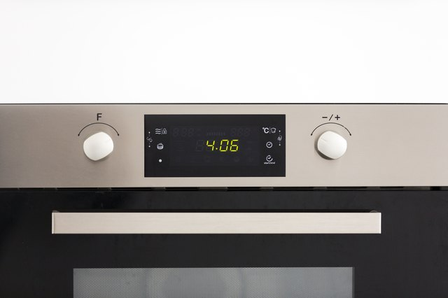 Close-up of modern oven, baking time, kitchen interior