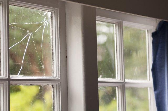 Broken window in an old home