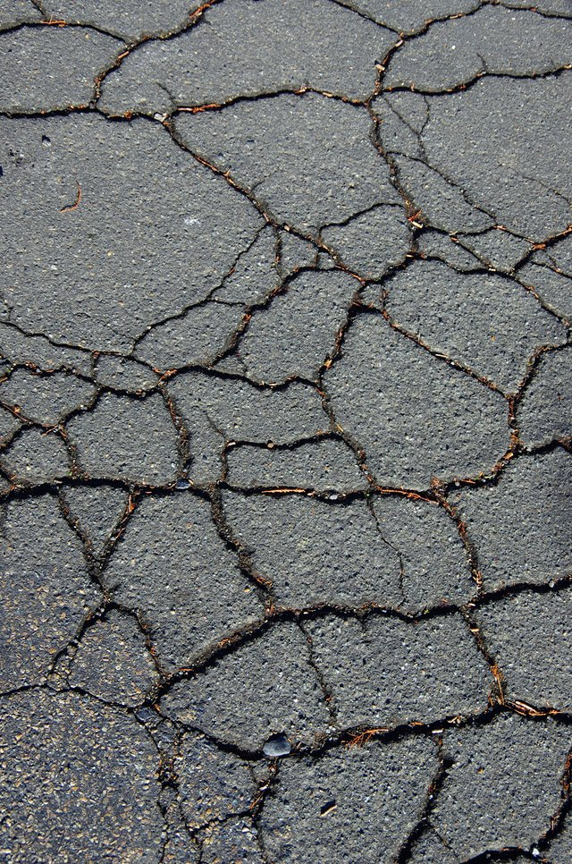 Cracked asphalt road.