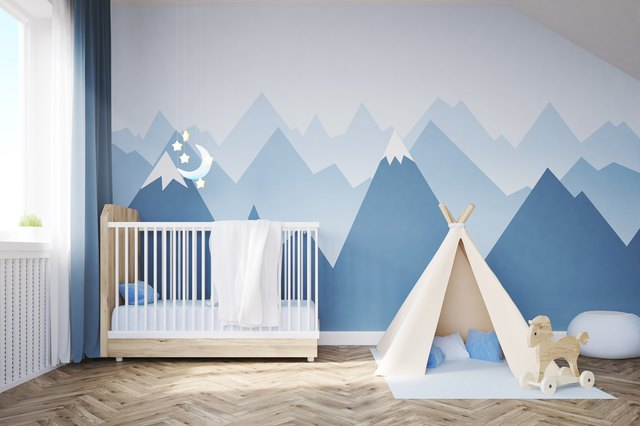 Baby's room with a bed and tent
