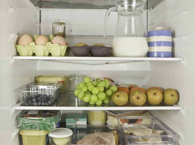 Three fridge shelves full of food