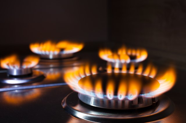 Orange flame at gas stove