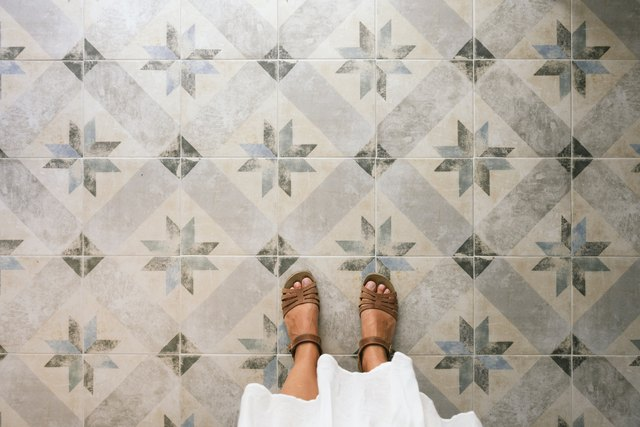 Woman standing on ornate tiled floor