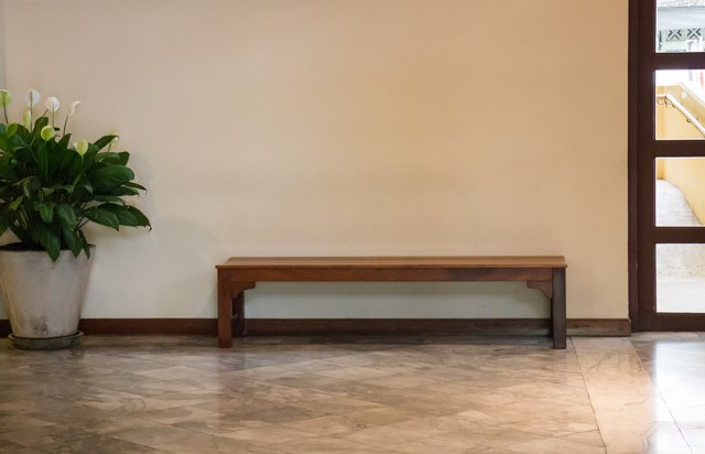 White Wall And Wooden bench