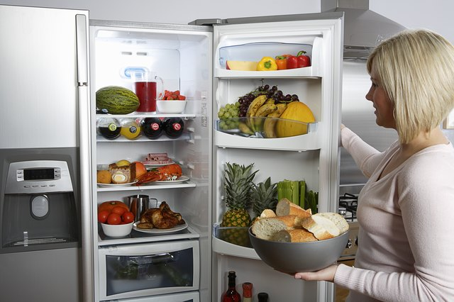 Woman opening a fridge