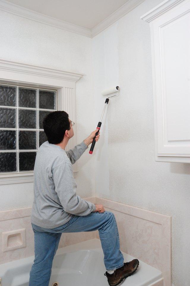 Man Applying Primer to Bathroom Wall