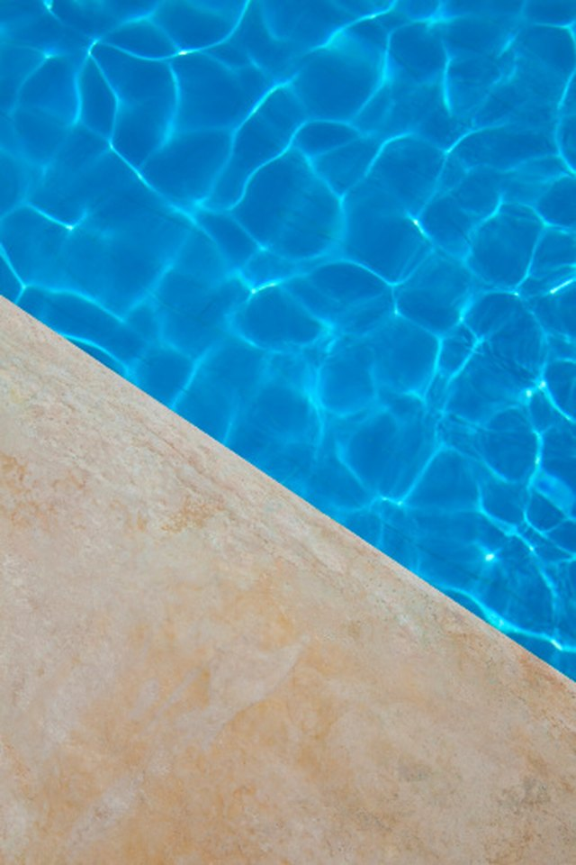 How to Stain Concrete Around a Swimming Pool | Hunker