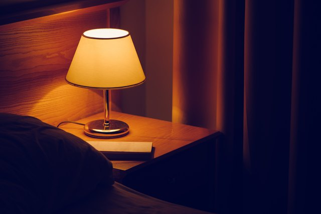 Electric lamp and book on bedside