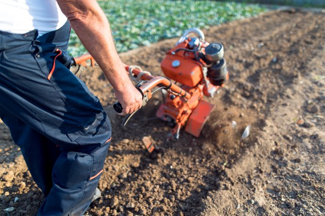 Working man with motor cultivator
