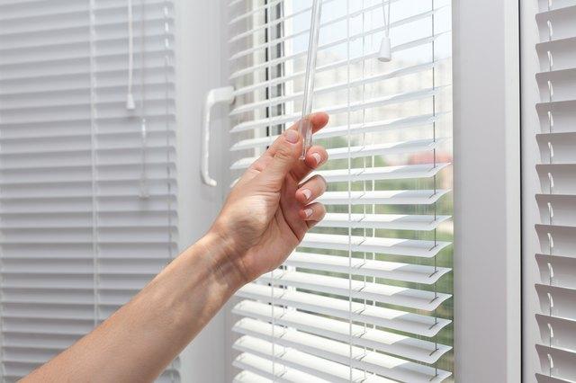 How to lower blinds hunker adjustments room lighting range through the blinds solutioingenieria Images