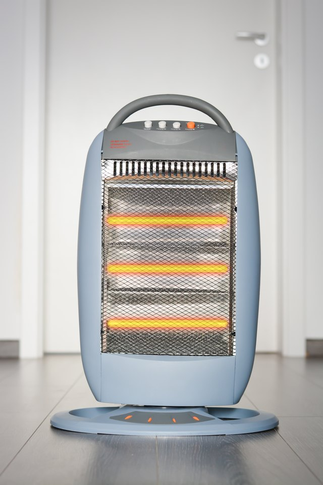 Halogen or infra heater in action against wooden floor