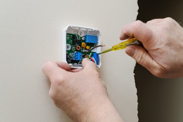 Installing a programmable room thermostat.