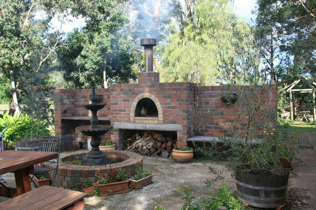 outdoor brick pizza oven and fountain