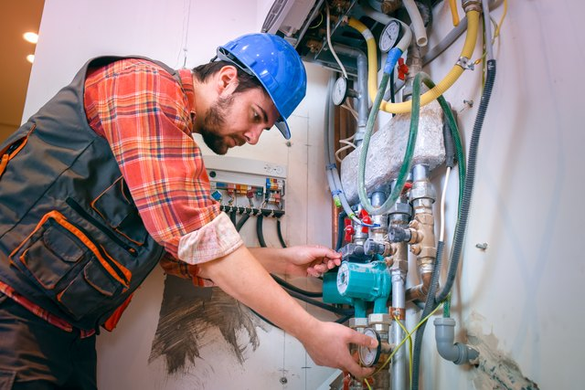 Technician installing heating system