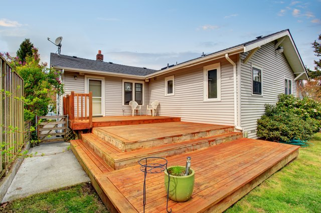 Picture of Large wooden back deck with two chairs.
