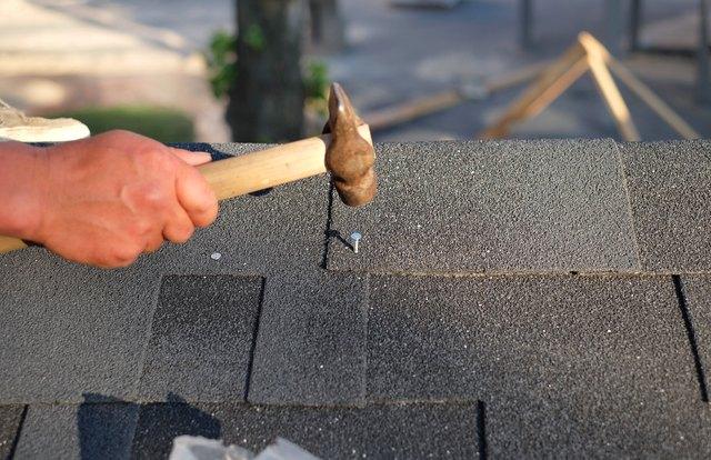 Contractor  nailing shingles.