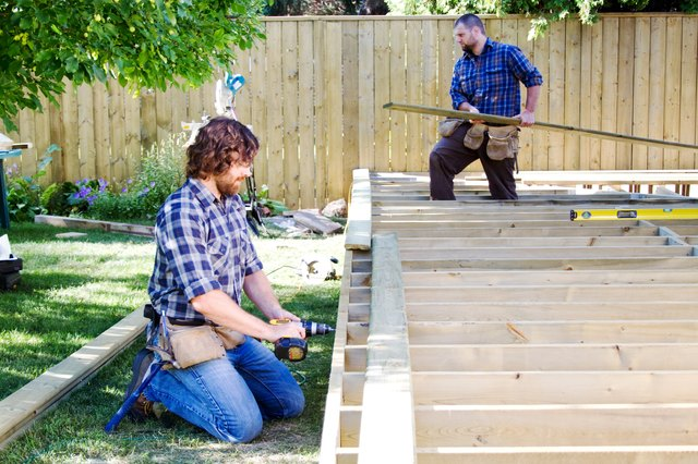 Two men building a deck