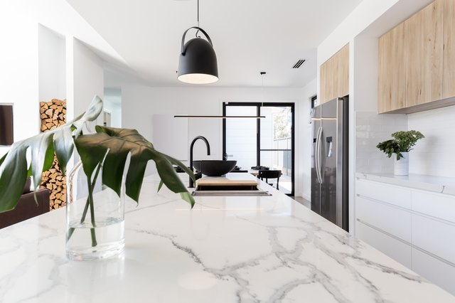 Kitchen marble bench close up with black hanging pendant