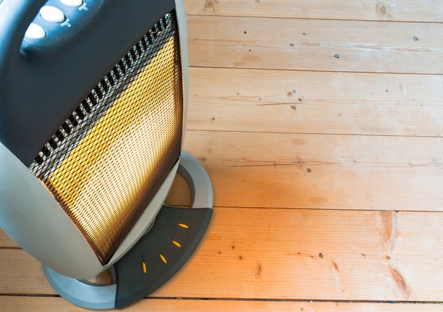 Halogen  heater on wooden floor.
