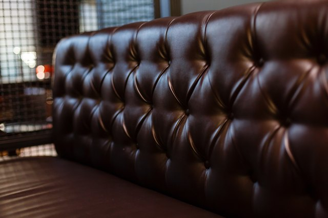 Genuine leather upholstery background for a luxury decoration in Brown tones