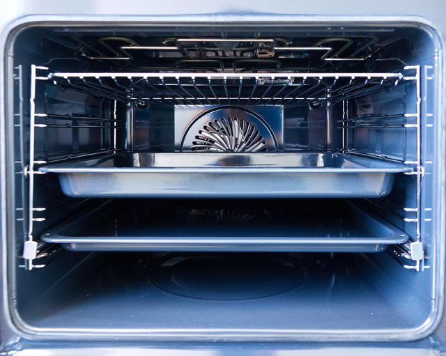 Modern oven with tray inside