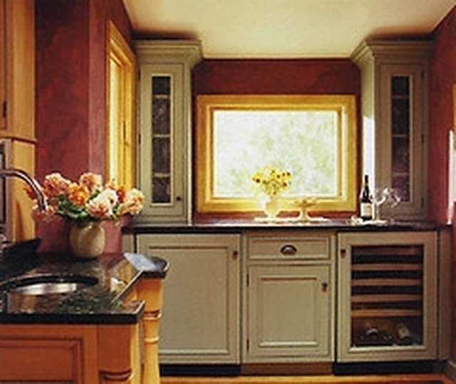 can u paint kitchen cabinets how to paint laminate cabinets hunker 13207