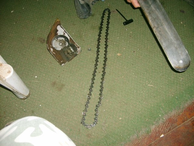 How to put a chain back on a chainsaw hunker bar chain and cover chainsaw wrench greentooth Image collections
