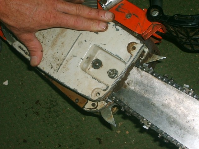 How to put a chain back on a chainsaw hunker replace the cover plate greentooth Choice Image