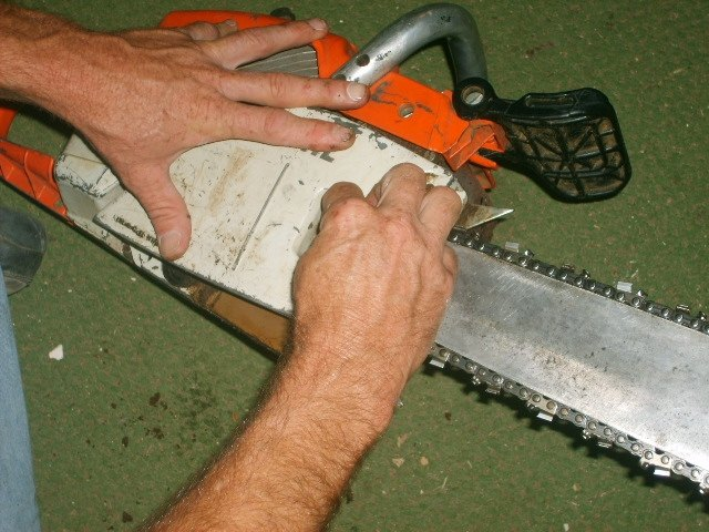 How to put a chain back on a chainsaw hunker replace the cover plate housing screws greentooth Images