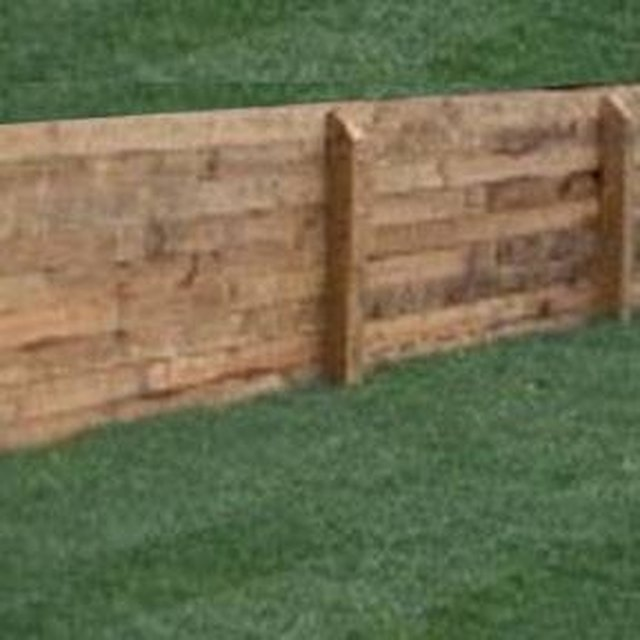 How to Build a Pressure Treated Retaining Wall | Hunker
