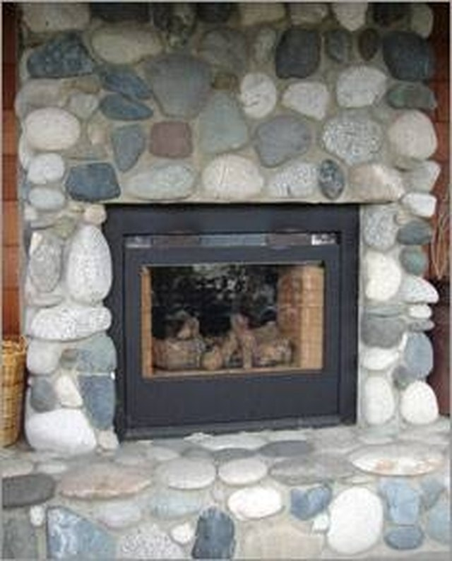 How to install river rock on a fireplace surround hunker installing river rock to your fireplace surround is a moderately simple do it yourself project solutioingenieria