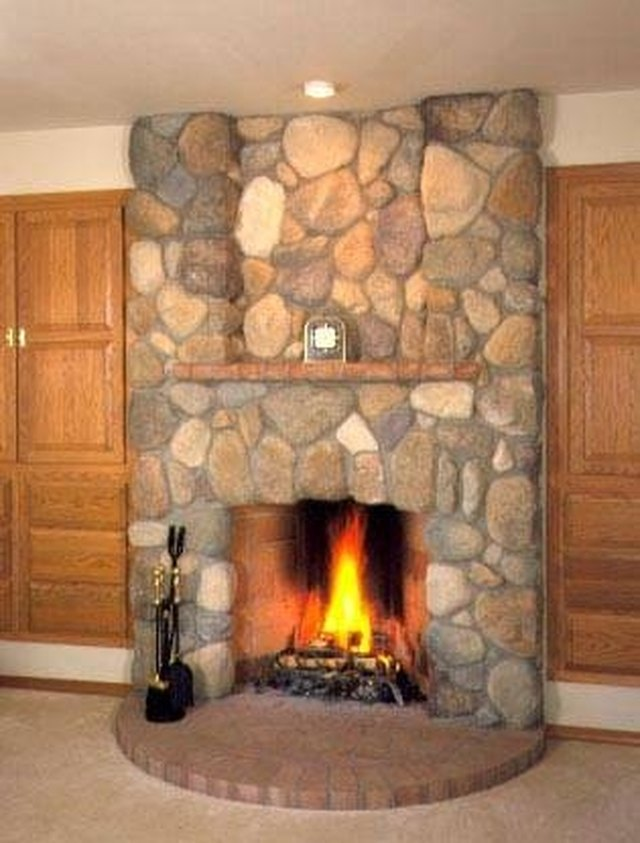How to install river rock on a fireplace surround hunker install river rock on your fireplace surround for a natural appeal solutioingenieria Choice Image