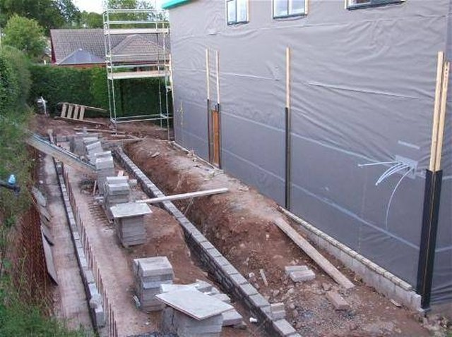 How to build a cinder block house hunker stocked block job solutioingenieria Images