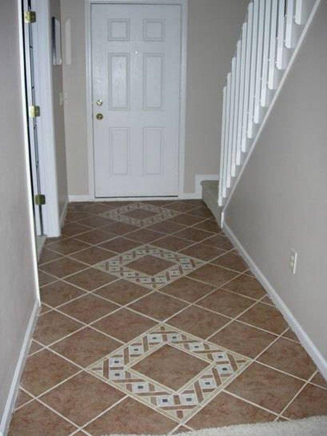 how to stain tile floors hunker. Black Bedroom Furniture Sets. Home Design Ideas