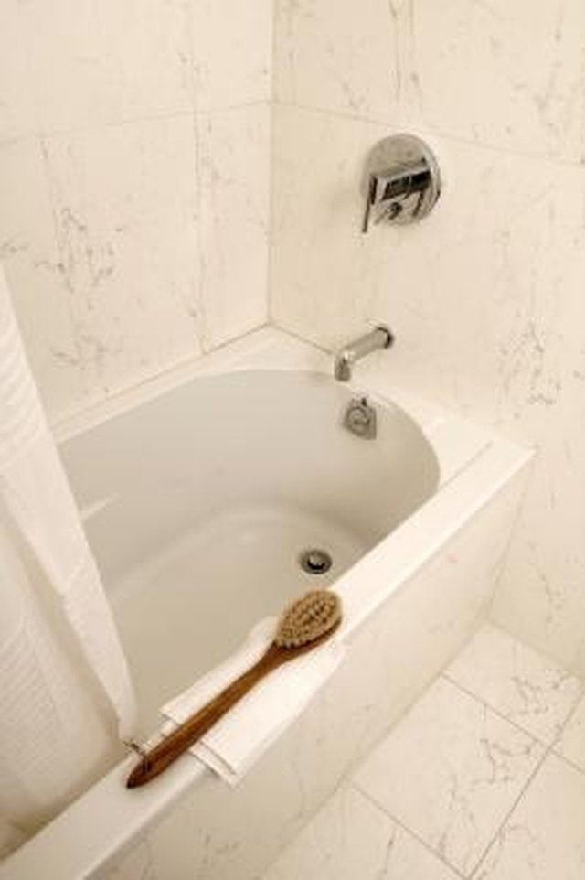 How to Fix a Tub Faucet When Water Comes Out Both Showerhead ...