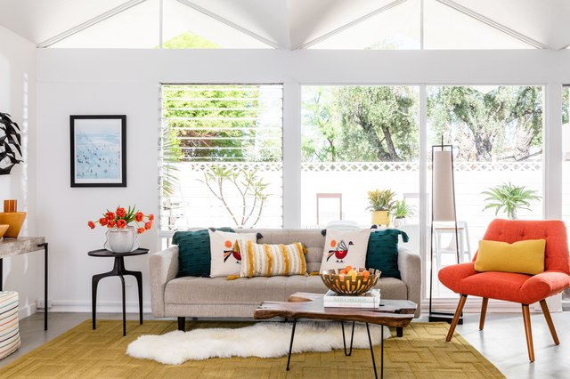 We're Excited to Come Home to This Cheery, Mod-Meets-Boho Living Room | Hunker