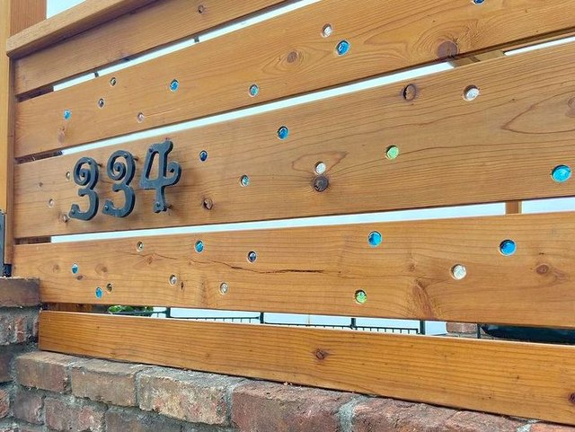 This Woman Created a Stained Glass Fence With Marbles | Hunker