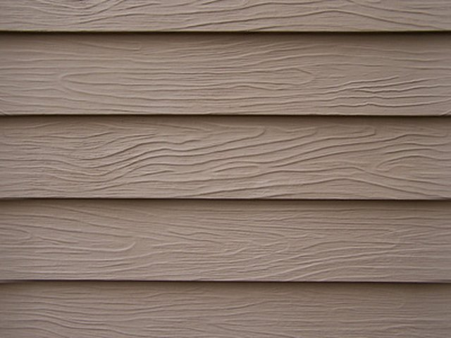 How To Hang Without Putting A Hole In Vinyl Siding Hunker