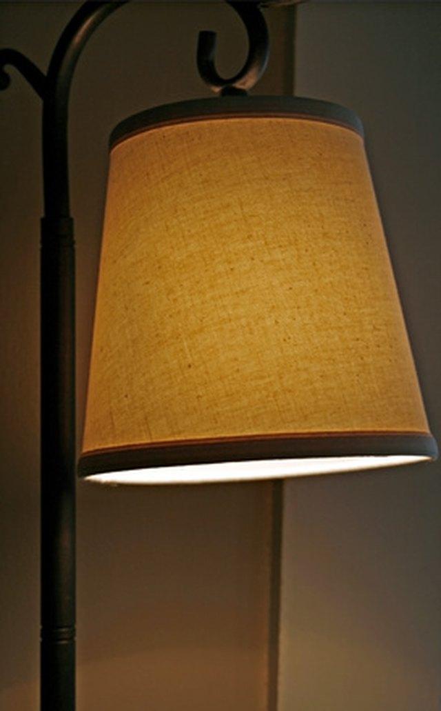 How to repair a lamp shade hunker step 1 vacuum the lamp shade aloadofball Choice Image