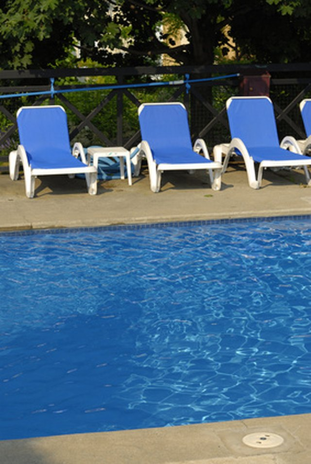 How to remove paint from a concrete pool deck hunker - Swimming pool paint for concrete pools ...