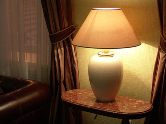 How to create your own lamp shade with parchment paper hunker step 1 select a simple cone shaped lampshade aloadofball Choice Image