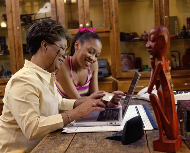 Grandmother and granddaughter shopping online