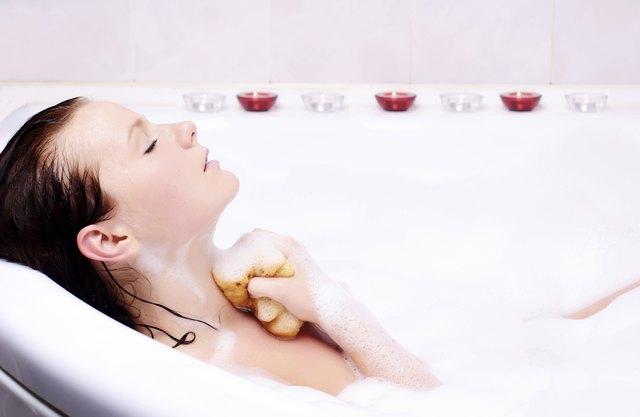 Young woman enjoys the bath-foam