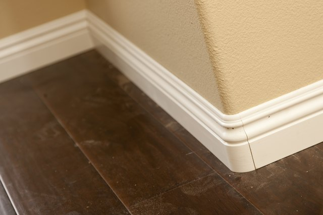 New Baseboard, Bull Nose Corners with Newly Installed Laminate Flooring