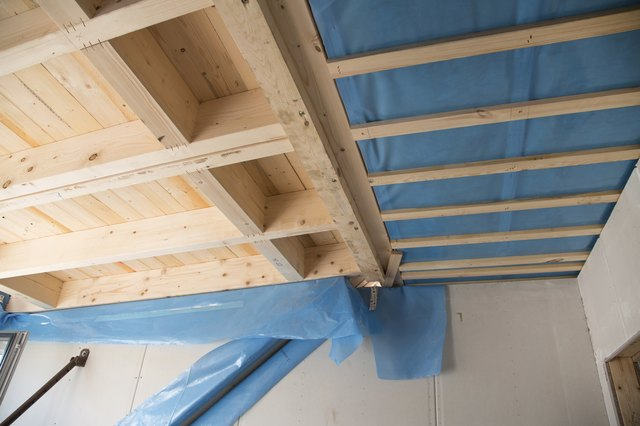 Heat isolation in a new prefabricated house with mineral wool.