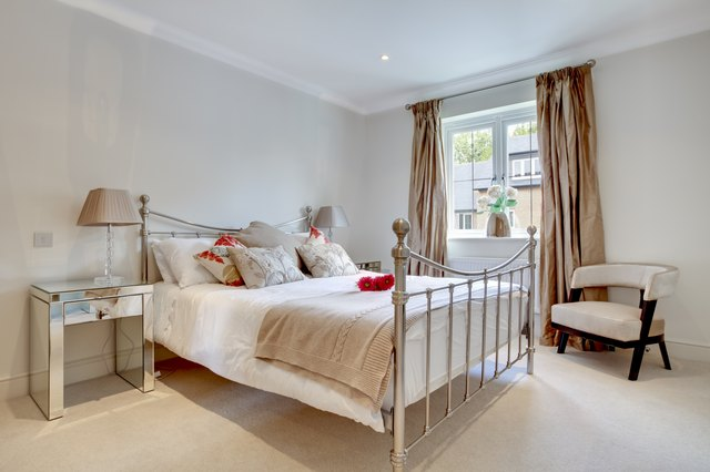 Metal bedsteads add a decorative touch to the bedroom.