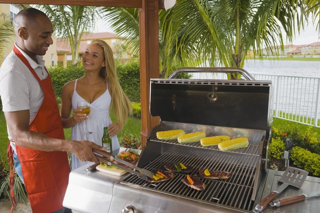 Multi-ethnic couple barbecuing